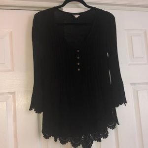 Women's boho black top with lace trim.